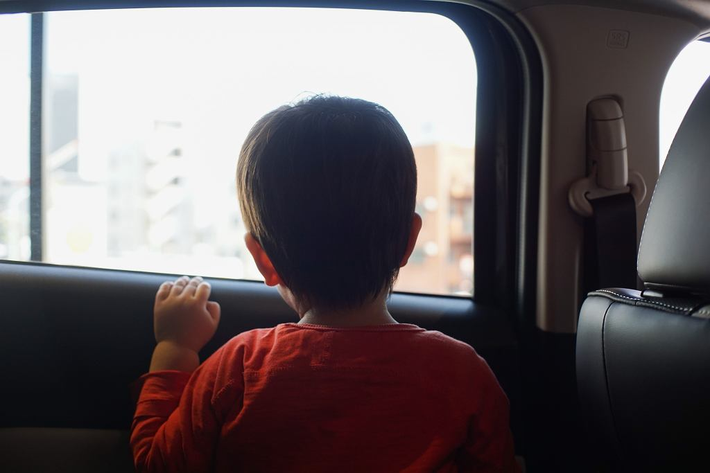 /Little,Boy,Sitting,In,The,Car,And,Look,Out,From