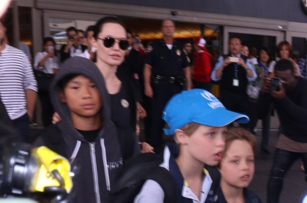 Angelina Jolie and Brad Pitt arrive at LAX airport with their six children.  Pictured: Angelina Jolie, Pax Jolie-Pitt, Shiloh Jolie-Pitt and Knox Jolie-Pitt