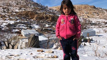 Nour, dziewczynka mieszkająca w obozie uchodźców syryjskich w Arsalu