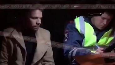 Jewgenij Baszkirow (z lewej) zatrzymany przez rosyjską policję