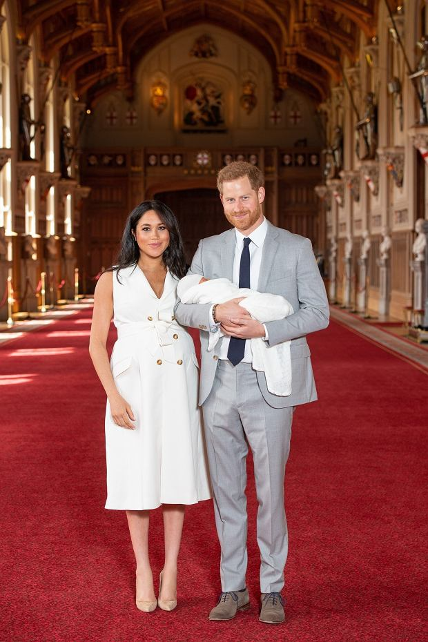 EMBARGOED to 1240 WEDNESDAY MAY 08 2019. The Duke and Duchess of Sussex with their baby son, who was born on Monday morning, during a photocall in St Georges Hall at Windsor Castle in Berkshire.
