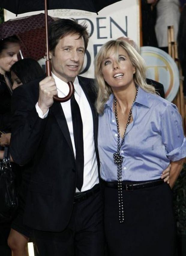 David Duchovny and Tea Leoni arrive at the 67th Annual Golden Globe Awards on Sunday, Jan. 17, 2010, in Beverly Hills, Calif. (AP Photo/Matt Sayles)