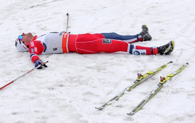 FILE - A Sunday, Dec. 29, 2013 photo from files showing Petter Northug of Norway laying in the finish area during the men freestyle 1.5 km sprint qualification at the cross country Tour de Ski competition in Oberhof, Germany. Northug, the Norwegian double gold medalist in Vancouver four years ago and a nine-time world champion, had a stubborn virus at the start of the season that set back his preparations. He has only won one race so far on the World Cup _ a 10-kilometer stage on the Tour de Ski _ but says he?s back to full fitness and will be a threat again in Sochi. ?I?m way ahead of where I should be (fitness wise),? Northug said after the recently concluded Norwegian championships. ?The plan is to really top my form for Sochi. ... I won?t be satisfied unless I get a gold.? (AP Photo/Jens Meyer, File)