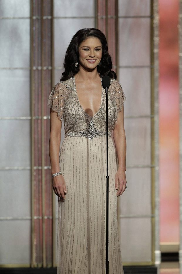 Presenter Catherine Zeta-Jones on stage at the 70th annual Golden Globe Awards in Beverly Hills, California January 13, 2013, in this picture provided by NBC. REUTERS/Paul Drinkwater/NBC/Handout  (UNITED STATES - Tags: ENTERTAINMENT) (GOLDENGLOBES-SHOW)   ATTENTION EDITORS - THIS IMAGE WAS PROVIDED BY A THIRD PARTY. FOR  EDITORIAL USE ONLY. NOT FOR SALE FOR MARKETING OR ADVERTISING CAMPAIGNS. THIS PICTURE IS DISTRIBUTED EXACTLY AS RECEIVED BY REUTERS, AS A SERVICE TO CLIENTS. NO SALES. NO ARCHIVES