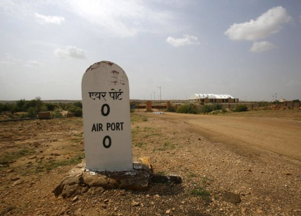 A milestone is seen outside the Jaisalmer Airport in desert state of Rajasthan, India, August 13, 2015. Two-and-a-half years after the completion of a new $17 million terminal building, the airport in Jaisalmer, a small and remote desert city in India's western Rajasthan state, stands empty. Not a single passenger has passed through the gates of an airport big enough to handle more than 300,000 travellers a year, with parking bays for three 180-seater narrow-body jets. India has spent more than $50 million since 2009 on eight airports that do not receive scheduled flights - white elephants that are a reminder of the pitfalls for Prime Minister Narendra Modi as he bets on an infrastructure drive to fuel growth. Picture taken August 13, 2015. REUTERS/Anindito Mukherjee