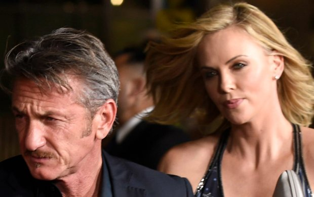 Sean Penn, left, and Charlize Theron arrive at the Los Angeles premiere of