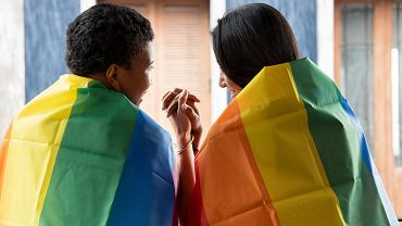 ?Black,African,Lgbt,Woman,Covering,Lgbtq,Rainbow,Flag,With,Asian