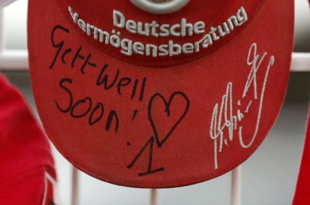 A cap marking the 45th birthday of seven-times former Formula One world champion Michael Schumacher is placed on a fence outside Schumacher's cart racing track in the western city of Kerpen January 3, 2014. Schumacher was in a stable condition on Wednesday, three days after suffering brain injuries in a skiing accident, his agent Sabine Kehm said outside the French hospital treating him.  Schumacher, who turns 45 today, is battling for his life after slamming his head against a rock while skiing off-piste in the French resort of Meribel on Sunday.  REUTERS/Ina Fassbender (GERMANY - Tags: SPORT MOTORSPORT HEALTH)
