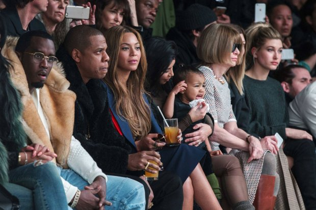 vKim Kardashian attempts to calm her daughter, North, while sitting next to Sean Combs (L), Jay-Z (2nd L), Beyonce (3rd L) and Anna Wintour (2nd R) as they watch a presentation of Kanye Wests Fall/Winter 2015 partnership with Adidas at New York Fashion Week February 12, 2015. REUTERS/Lucas Jackson (UNITED STATES - Tags: FASHION SOCIETY ENTERTAINMENT TPX IMAGES OF THE DAY)