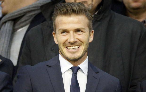 Paris Saint Germain's David Beckham smiles before their Champions League soccer match against Valencia in Valencia February 12, 2013.  REUTERS/Sergio Perez  (SPAIN - Tags: SPORT SOCCER)
