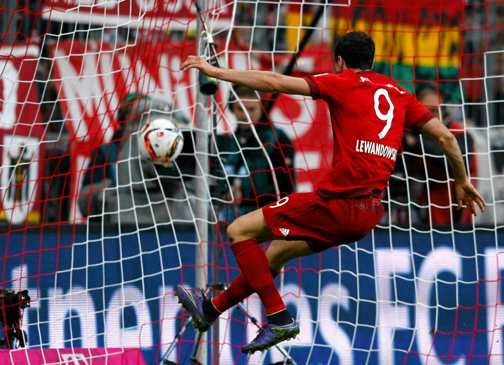 Bayern Munich's Robert Lewandowski scores a goal against Borussia Dortmund during their German first division Bundesliga soccer match in Munich,