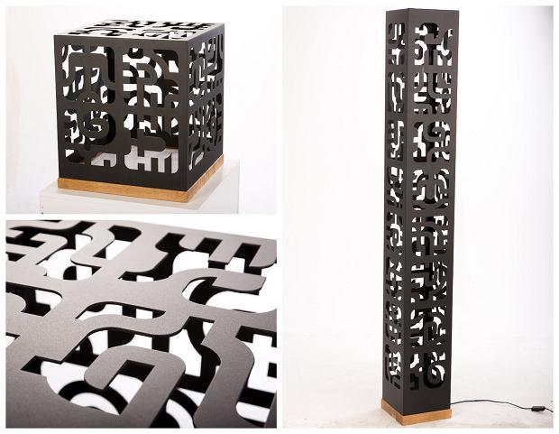 Lampy Cut-out, dostępne w trzech rozmiarach: tower 168x22x22 cm; seat 50x50x50 cm; box - 38x32,5x32,5 cm. Materiał: drewno dębowe, metal malowany proszkowo na biało lub czarno. Cena: tower -3200zł;  seat - 3500 zł;  box - 1590 zł