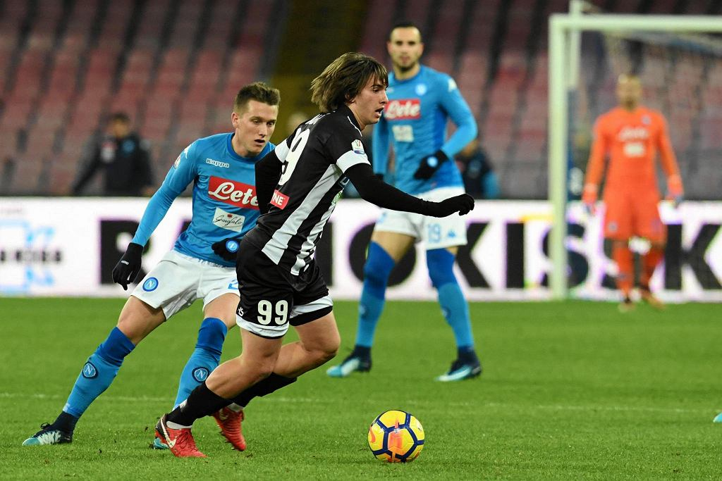 Udinese's Andrija Balic, right, and Napoli's Piotr Zielinski