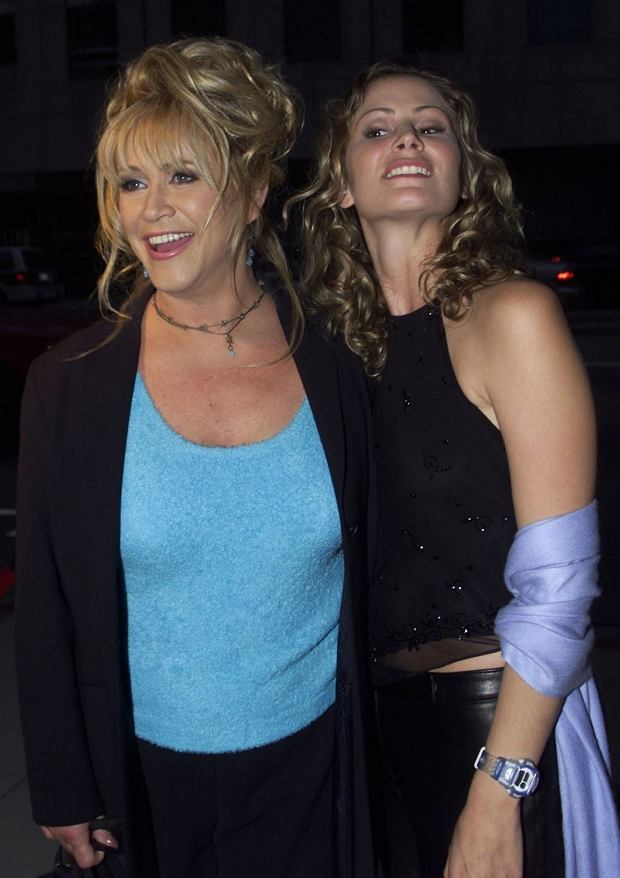"""LOA12D:PREMIERE:BEVERLY HILLS,CALIFORNIA,28APR00 - Adult film star Marilyn Chambers (L) and actress Tracy Hutson, who portrays Chambers in the movie """"Rated X,"""" pose at the film's premiere at the Academy of Motion Picture Arts and Sciences, in Beverly Hills April 27.  jc/Photo by Jill Connelly REUTERS"""