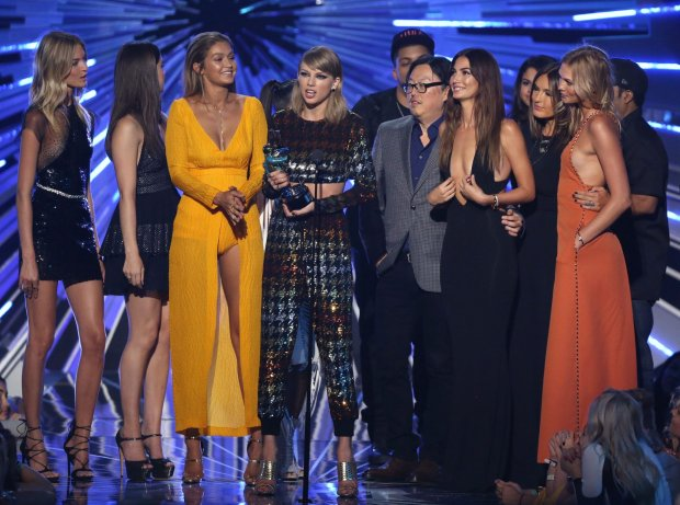 Taylor Swift, center, accepts the award for video of the year for