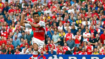 Arsenals Sanchez scores a goal against Manchester City during their English Premier League soccer match at the Emirates stadium in London