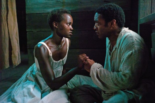 12 YEARS A SLAVE, l-r: Lupita Nyong'o, Chiwetel Ejiofor, 2013, ph: Francois Duhamel/TM and Copyright ?Fox Searchlight Pictures. All rights reserved./courtesy Everett Collection