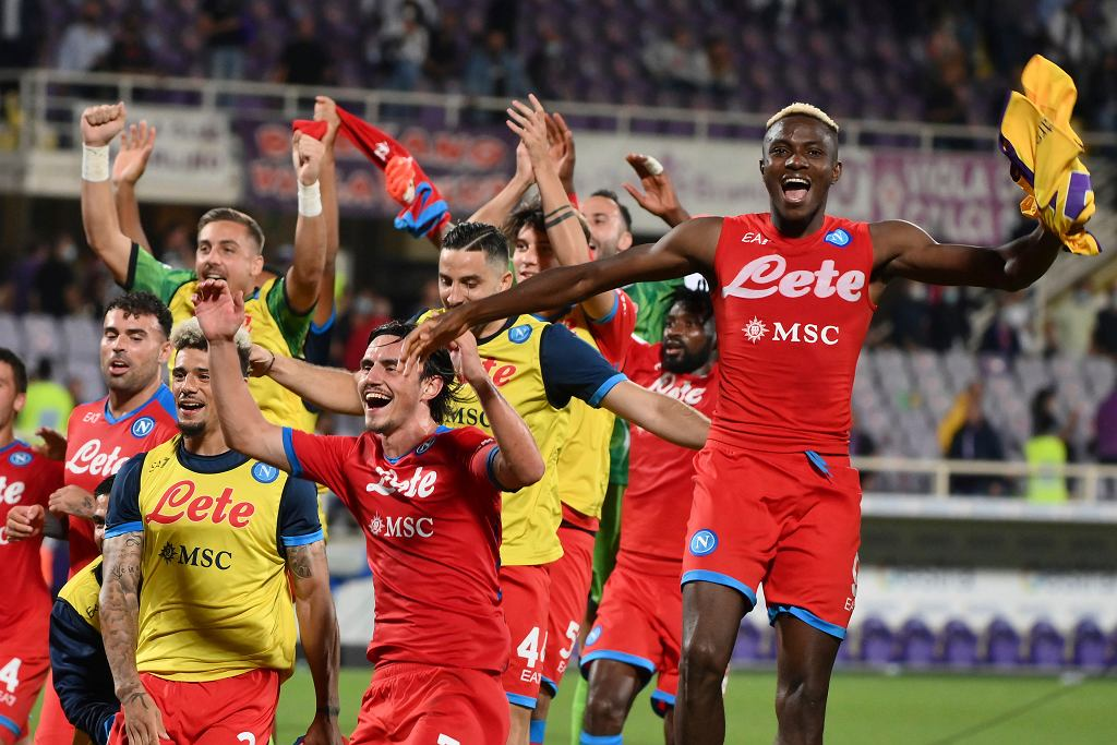 Napoli's Victor Osimhen celebrates with teammates his side's 2-1 win at the end of the Serie A soccer match between Fiorentina