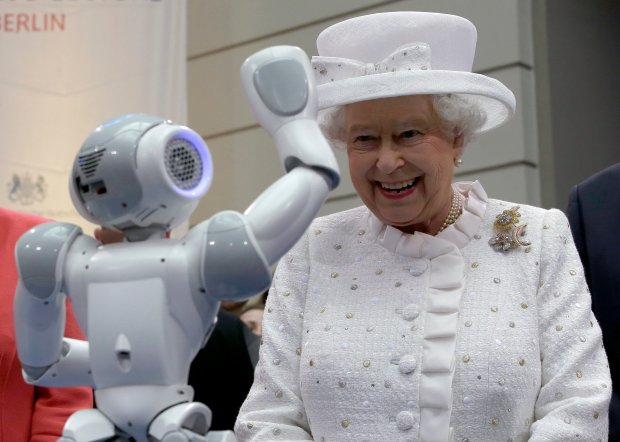 Britain's Queen Elizabeth II smiles as a little robot waves to the her during a reception at the 'Technische Universitaet' (Technical University) in Berlin, Germany, Wednesday, June 24, 2015.  Queen Elizabeth II and her husband Prince Philip are on an official visit to Germany until Friday, June 26. (AP Photo/Michael Sohn, pool)