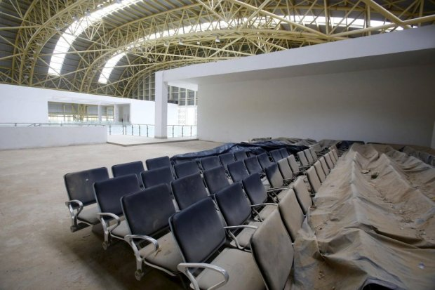 Dust covered seats are pictured inside the lounge of the Jaisalmer Airport in desert state of Rajasthan, India, August 13, 2015. Two-and-a-half years after the completion of a new $17 million terminal building, the airport in Jaisalmer, a small and remote desert city in India's western Rajasthan state, stands empty. Not a single passenger has passed through the gates of an airport big enough to handle more than 300,000 travellers a year, with parking bays for three 180-seater narrow-body jets. India has spent more than $50 million since 2009 on eight airports that do not receive scheduled flights - white elephants that are a reminder of the pitfalls for Prime Minister Narendra Modi as he bets on an infrastructure drive to fuel growth. Picture taken August 13, 2015. REUTERS/Anindito Mukherjee