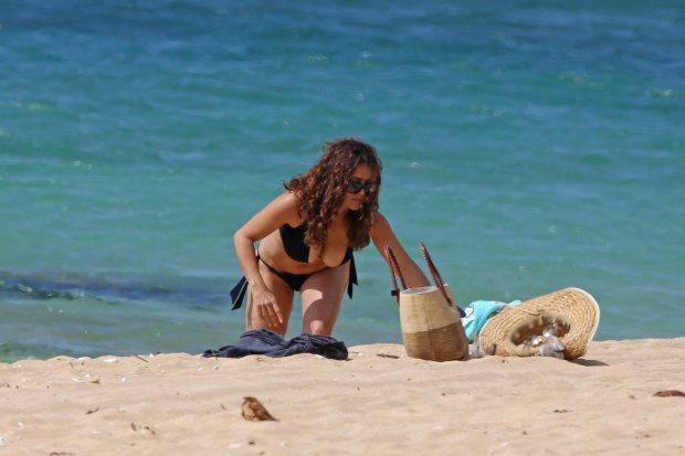 EXCLUSIVE: **PREMIUM RATES APPLY** **NO WEB UNTIL 0530AM GMT AUGUST 18, 2015** A bikini clad Salma Hayek and shirtless Pierce Brosnan spend a day at the beach together in Hawaii.  Pictured: Salma Hayek