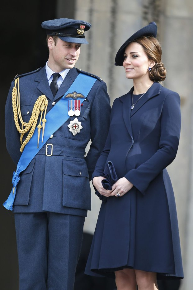 Britain's Duke of Cambridge and Duchess of Cambridge stand at the steps of St Paul's Cathedral, in central London, after attending a service of commemoration to pay tribute to members of the British armed forces past and present who served on operations in Afghanistan, Friday, March 13, 2015. (AP Photo/Lefteris Pitarakis)