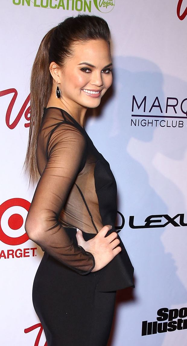 "LAS VEGAS, NV - FEBRUARY 13: Chrissy Teigen attends the ""SI Swimsuit On Location Party"" held at Marquee Nightclub at The Cosmopolitan on February 13, 2013 in Las Vegas, Nevada. PHOTOGRAPH BY Photo Image Press / Barcroft Media UK Office, London. T +44 845 370 2233 W www.barcroftmedia.com USA Office, New York City. T +1 212 796 2458 W www.barcroftusa.com Indian Office, Delhi. T +91 11 4053 2429 W www.barcroftindia.com"