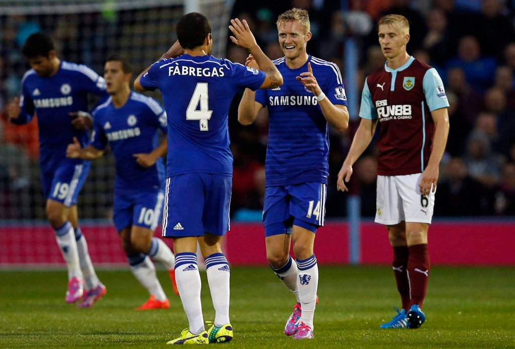 Chelsea's Andre Schurrle (2nd R) celebrates his goal against Burnley with teammate Cesc Fabregas during their