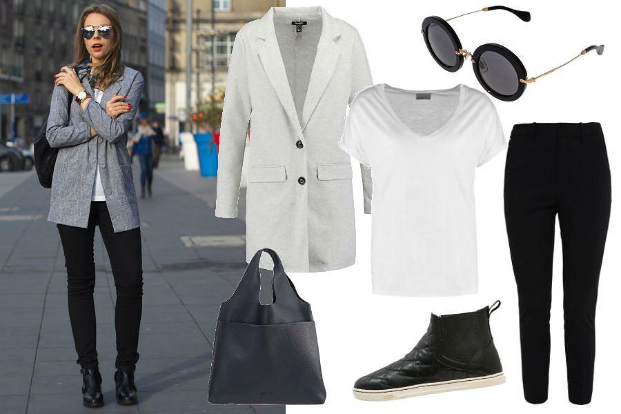 Julita Buczek, czarne spodnie, biała bluzka, duże okulary