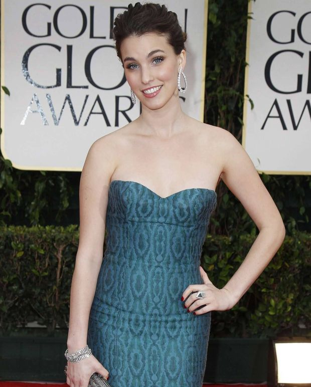 Rainey Qualley, who is Miss Golden Globe 2012 and daughter of actress Andie MacDowell, poses at the 69th annual Golden Globe Awards in Beverly Hills, California January 15, 2012. REUTERS/Danny Moloshok (UNITED STATES - Tags: ENTERTAINMENT) (GOLDENGLOBES-ARRIVALS)