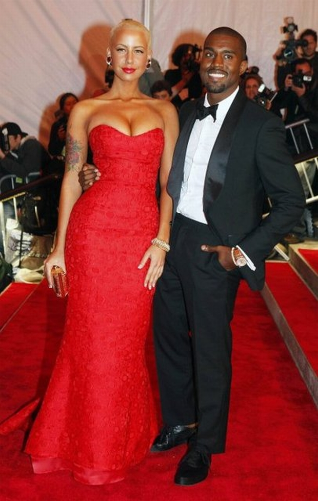"""Amber Rose and Kanye West arrive for the Metropolitan Museum of Art Costume Institute Gala, """"The Model As Muse: Embodying Fashion"""" in New York, May 4, 2009.     REUTERS/Eric Thayer (UNITED STATES ENTERTAINMENT FASHION)"""