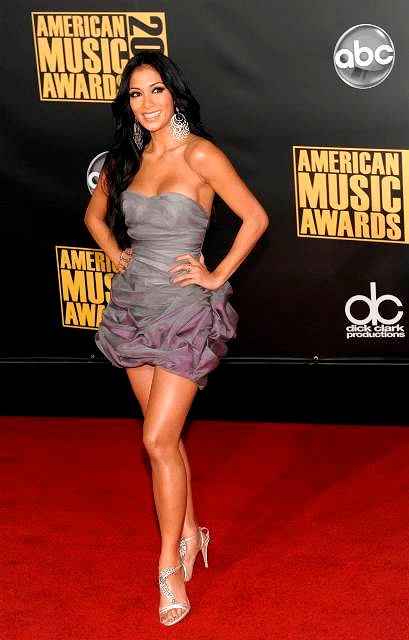 Nicole Scherzinger arrives at the American Music Awards in Los Angeles on Sunday, Nov. 23, 2008. (AP Photo/Chris Pizzello)