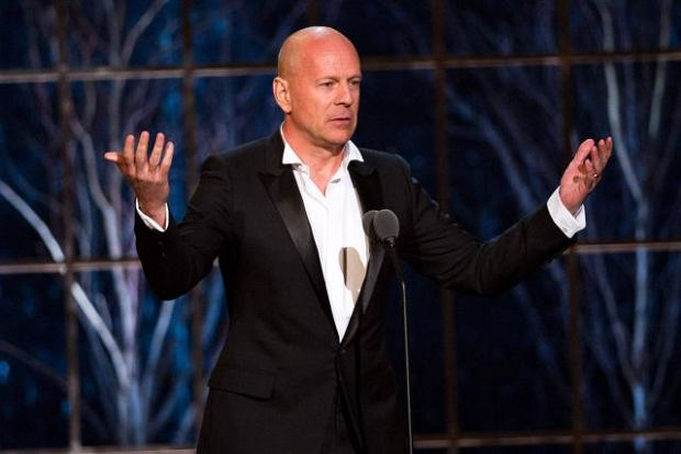 """Bruce Willis appears onstage at the """"The Comedy Awards? presented by Comedy Central in New York, Saturday, March 26, 2011. (AP Photo/Charles Sykes)"""
