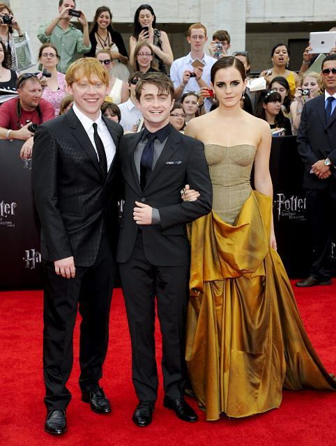 """Cast members Rupert Grint, left, Daniel Radcliffe and Emma Watson attend the premiere of """"Harry Potter and the Deathly Hallows: Part 2"""" at Avery Fisher Hall on Monday, July 11, 2011 in New York. (AP Photo/Evan Agostini)"""