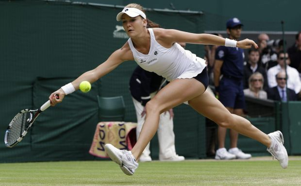 Agnieszka Radwanska of Poland plays a shot to Serena Williams of the United States during the women's final match at the All England Lawn Tennis Championships at Wimbledon, England, Saturday, July 7, 2012. (AP Photo/Kirsty Wigglesworth)