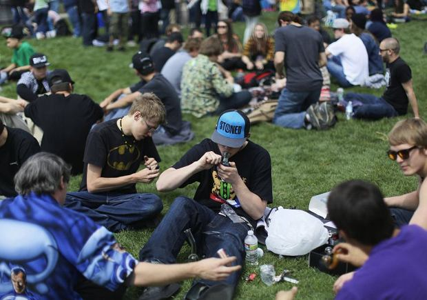 A man lights his pipe at the 4/20 pro-marijuana rally in Civic Center Park in downtown Denver April 20, 2013. Thousands of marijuana enthusiasts gathered for an annual weekend celebration of cannabis, the first such assemblage since Colorado voters legalized the recreational use of pot last fall. Two people were shot at the rally, police said. One person was shot in the leg and another was