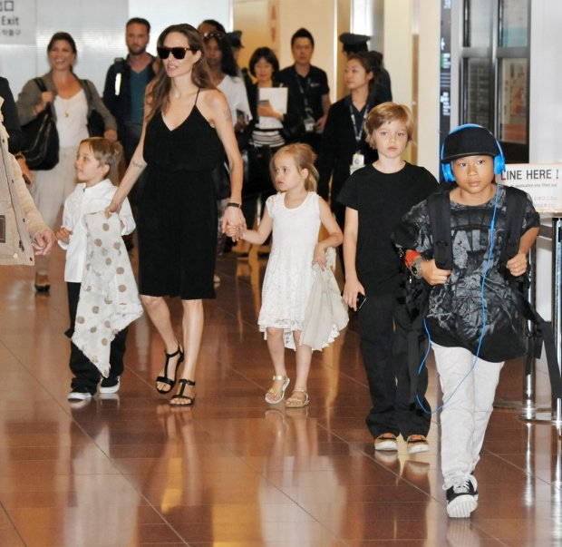 (L-R) Knox Leon Jolie-Pitt, Angelina Jolie, Vivienne Jolie-Pitt, Shiloh Jolie Pitt and Pax Thien Jolie-Pitt  arrive at Tokyo International Airport in Tokyo, Japan on June 21, 2014. Jolie and family are in Tokyo for the Japanese premiere of Maleficent.       UPI/Keizo Mori / eyevine