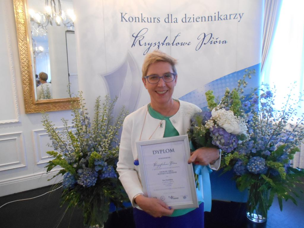 Ewa Podolska odbiera nagrodę