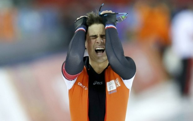 Jan Smeekens of the Netherlands reacts after his race two of the men's 500 meters speed skating event during the 2014 Sochi Winter Olympics, February 10, 2014.                REUTERS/Issei Kato (RUSSIA  - Tags: OLYMPICS SPORT SPEED SKATING)