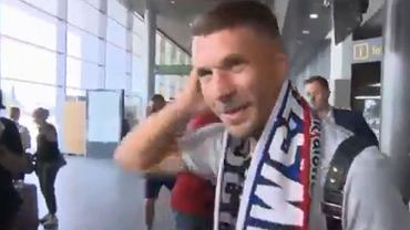 Lukas Podolski na lotnisku w Katowicach