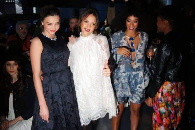 Australian model Miranda Kerr (L-R), actress Jessica Alba and Beyonce's sister Solange Knowles pose for photographers before H&M's Fall/Winter 2014-2015 women's ready-to-wear collection during Paris Fashion Week February 26, 2014. REUTERS/Stephane Mahe (FRANCE - Tags: FASHION ENTERTAINMENT)