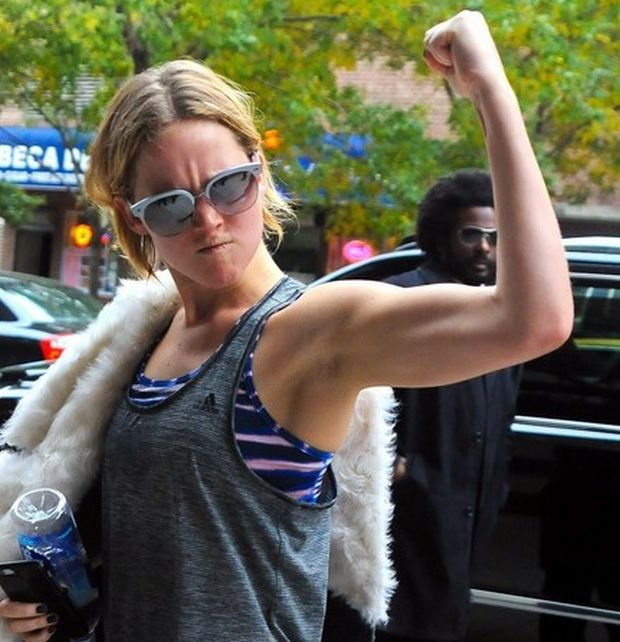 Jennifer Lawrence returns from Soul Cycle and shows her guns as she walks back into her hotel in Manhattan on Sunday November 16, 2014.  Pictured: Jennifer Lawrence