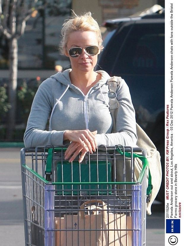 exclusive  Mandatory Credit: Photo by KM Press Group / Rex Features (2011526e)  Pamela Anderson  Pamela Anderson out and about, Los Angeles, America - 03 Dec 2012  Pamela Anderson chats with fans outside the Bristol Farms grocery store in Beverly Hills