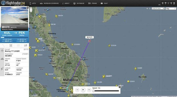 This screengrab from flightradar24.com shows the last reported position of Malaysian Airlines flight MH370, Friday night March 7, 2014. The Boeing 777-200 carrying 239 people lost contact over the South China Sea on a flight from Kuala Lumpur to Beijing, and international aviation authorities still hadn't located the jetliner several hours later. (AP Photo/flightradar24.com)