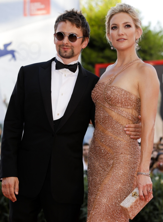 Actress Kate Hudson and musician Matt Bellamy arrive for the premiere of the movie 'The Reluctant Fundamentalist' that opens the 69th edition of the Venice Film Festival in Venice, Italy, Wednesday, Aug. 29, 2012. (AP Photo/Andrew Medichini)