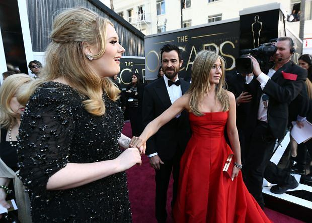 Adele, from left, Justin Theroux and Jennifer Aniston arrive at the Oscars at the Dolby Theatre on Sunday Feb. 24, 2013, in Los Angeles. (Photo by Matt Sayles/Invision/AP)