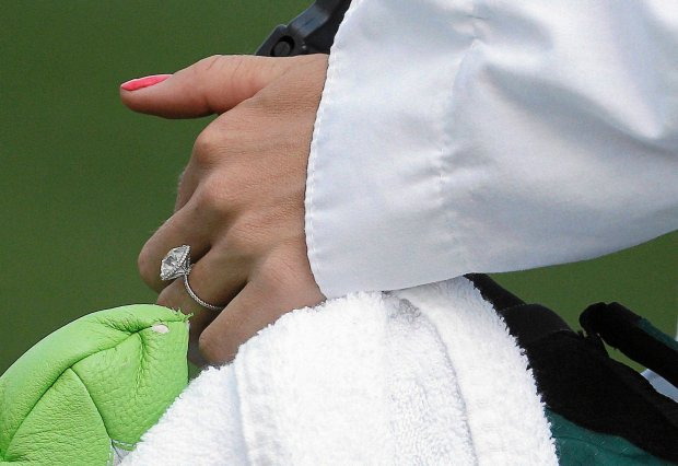 Tennis player Caroline Wozniacki wears her engagement ring from her fiancee Rory McIlroy, of Northern Ireland, during the par three competition at the Masters golf tournament Wednesday, April 9, 2014, in Augusta, Ga. (AP Photo/Darron Cummings)