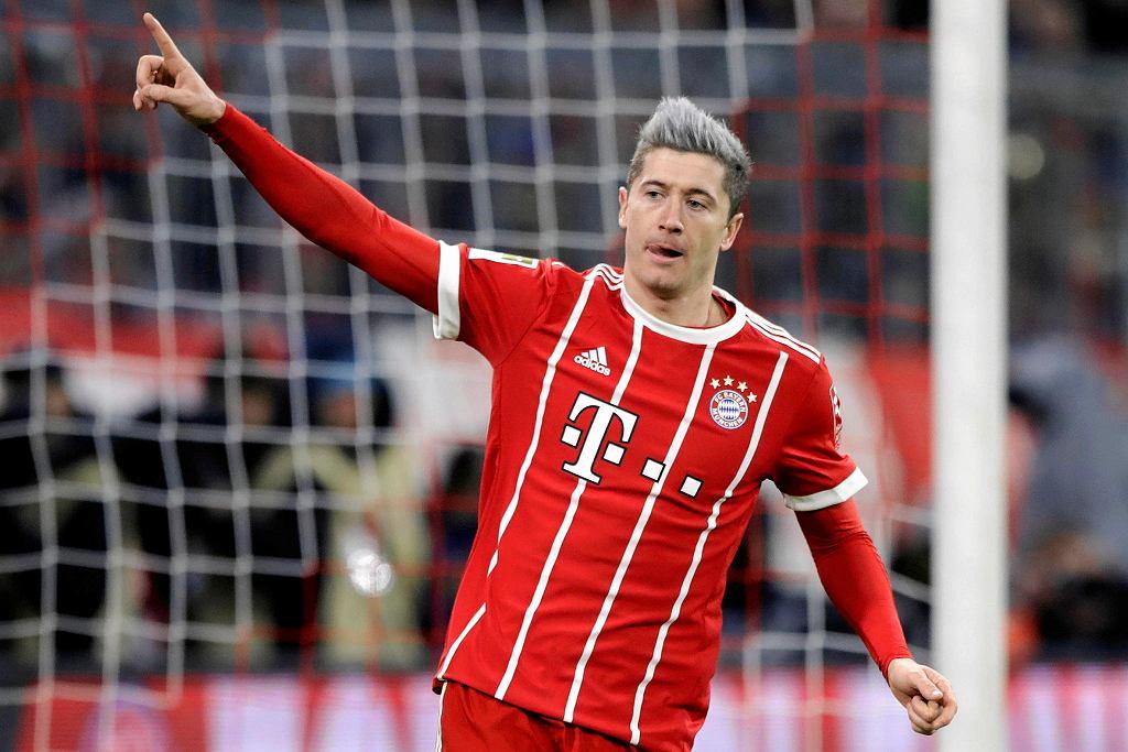 Bayern's Robert Lewandowski celebrates after scoring his side's opening goal during the German Soccer Bundesliga match between FC Bayern Munich and 1.FC Koeln in Munich