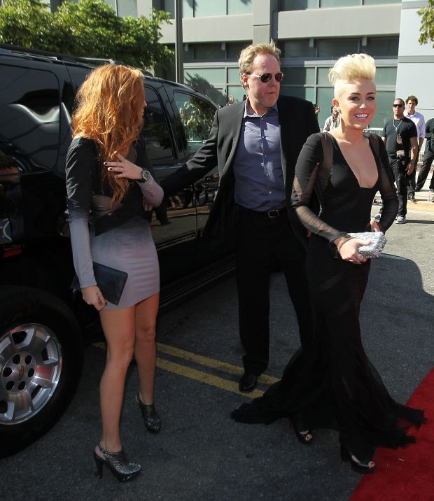 Actress-singer Miley Cyrus, center, arrives at the MTV Video Music Awards on Thursday, Sept. 6, 2012, in Los Angeles. (Photo by Matt Sayles/Invision/AP)