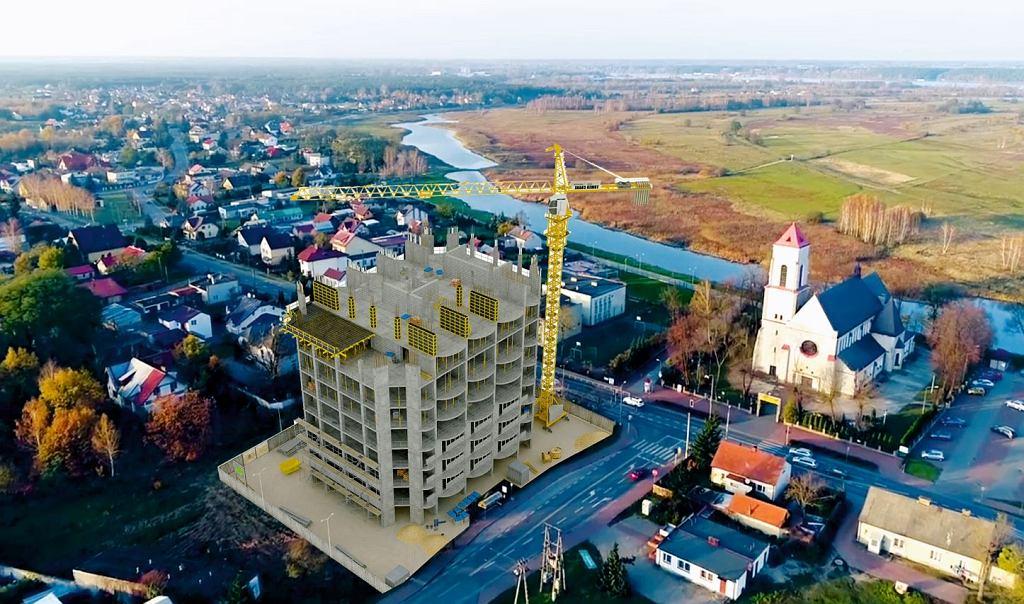 Przygotowana na zlecenie urzędu gminy wizualizacja siedmiopiętrowego bloku, który miał powstać w Wieliszewie koło Warszawy